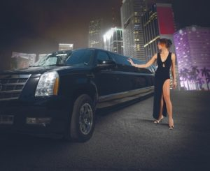 girl getting in black limousine